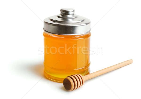 Honey jar and wooden drizzler Stock photo © Alexstar