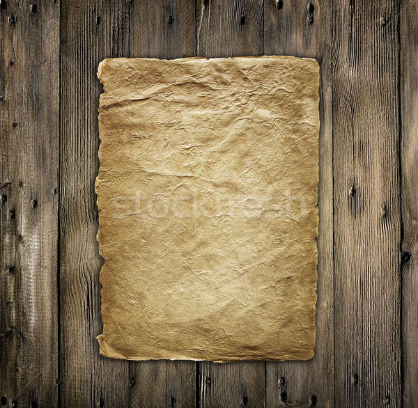 Paper on wooden surface Stock photo © Alexstar