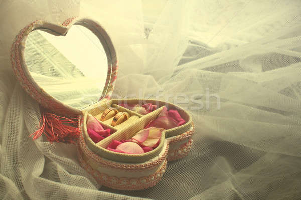 two Diamond Rings and Rose Petals Stock photo © Aliftin