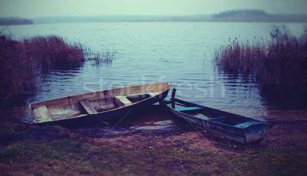 An old boats on the lake Stock photo © Aliftin