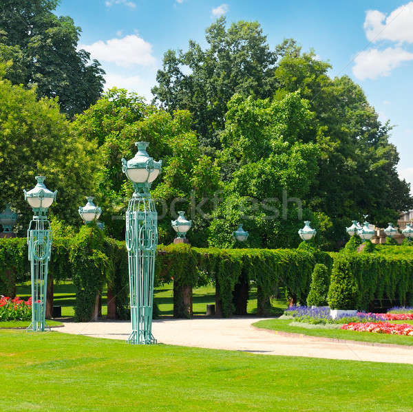 summer park with beautiful street lights, lawns and hedges Stock photo © alinamd