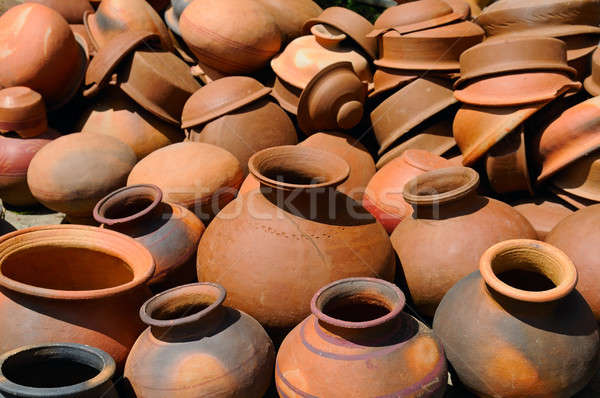 Background of a pots, dishes, and other articles made of baked c Stock photo © alinamd