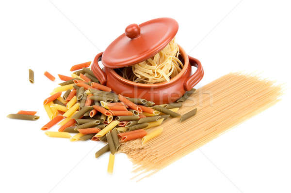 different types of pasta and a clay pot  Stock photo © alinamd