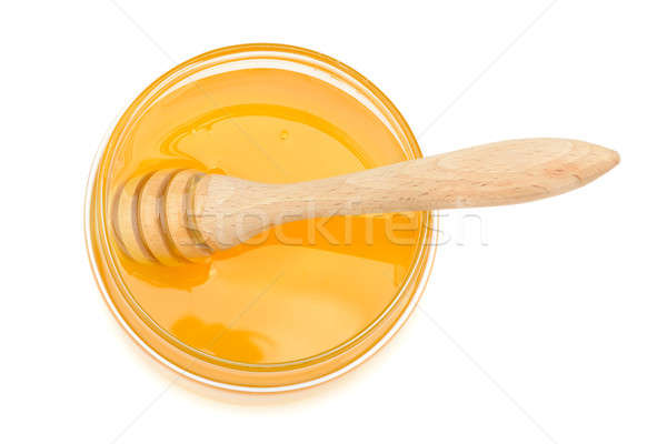 pot with honey and drizzler on a white background Stock photo © alinamd