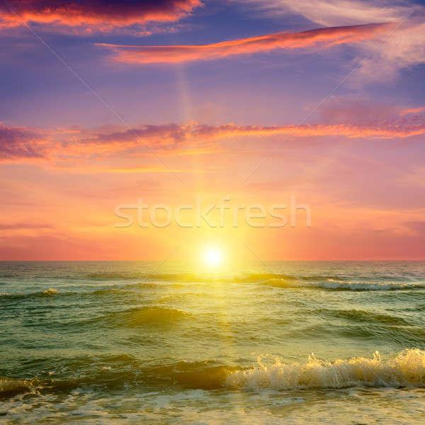 Okyanus bulutlu gökyüzü fantastik gün batımı güneş Stok fotoğraf © alinamd