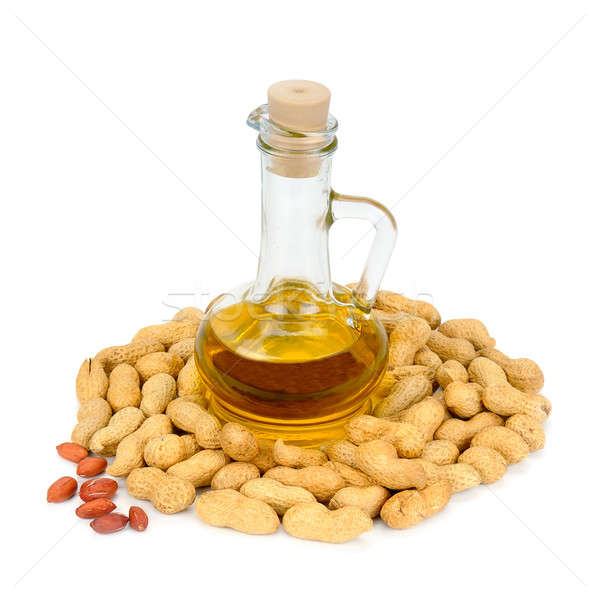 peanuts and oil in bottle isolated on white background Stock photo © alinamd