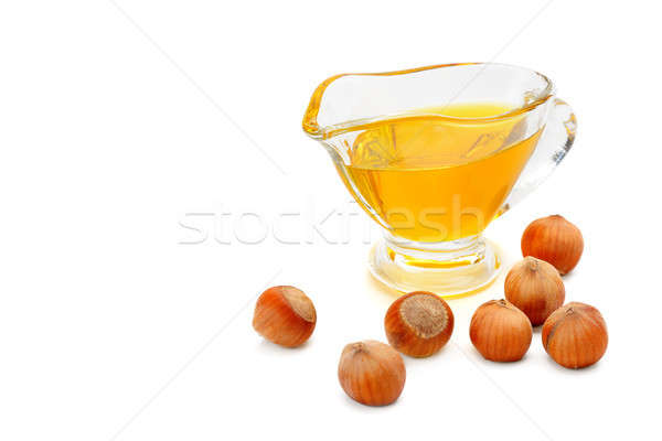 Oil and fruit hazelnut isolated on white. Free space for text. Stock photo © alinamd