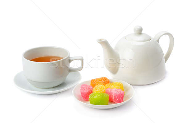 Teapot, tea in a cup and jujube isolated on white background. Stock photo © alinamd