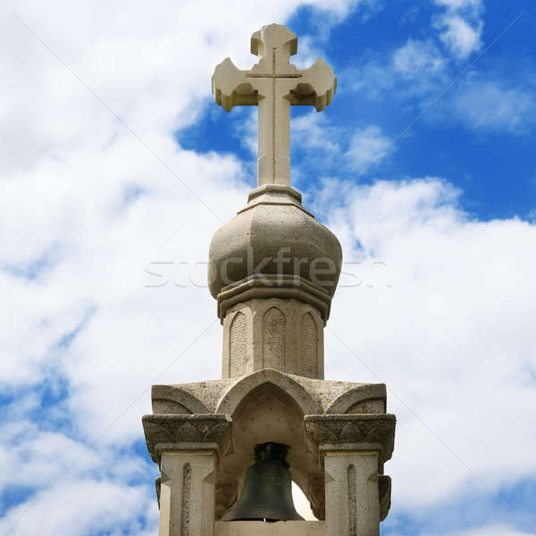 Stone cross on blue sky background Stock photo © alinamd