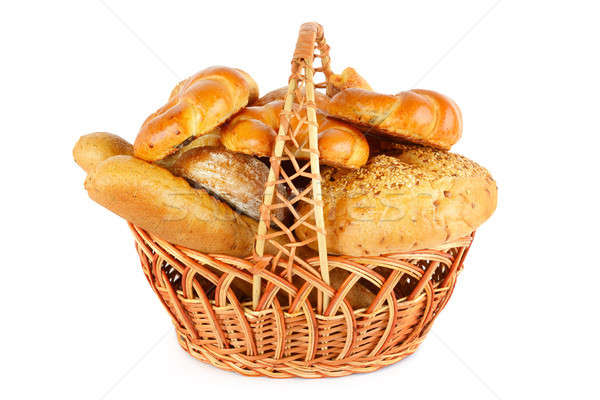 Bread in a wicker basket isolated on a white background Stock photo © alinamd