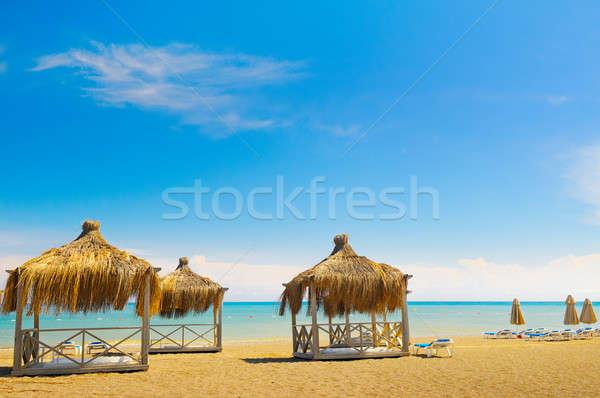 砂浜 空 水 雲 建物 太陽 ストックフォト © alinamd