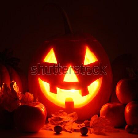 scary pumpkin head with glowing eyes - a symbol of Halloween Stock photo © alinamd