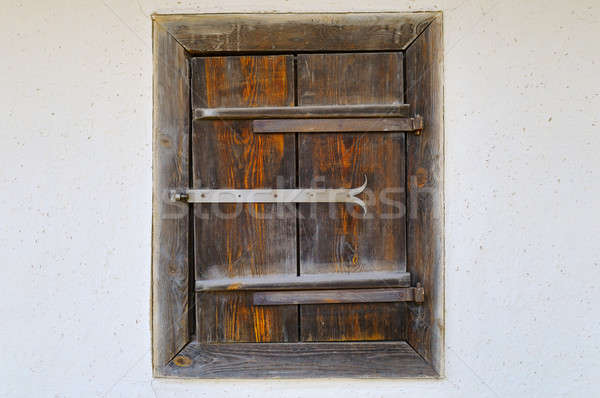 Old wooden window shutters on the clay wall of the house Stock photo © alinamd