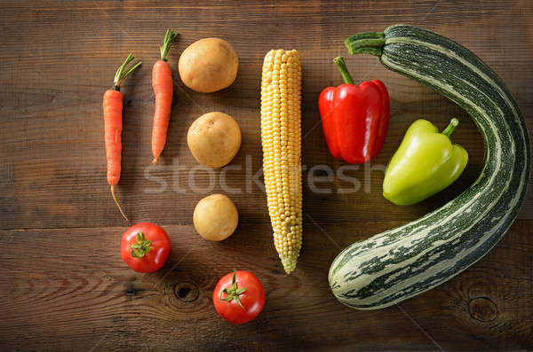Healthy food background .Different vegetables on old wooden tabl Stock photo © alinamd