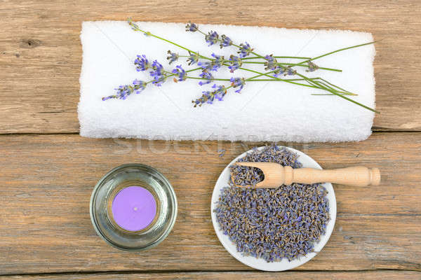 lavender flowers, aromatic candles, and towels on wooden backgro Stock photo © alinamd