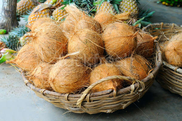 Coconuts in the basket in a vegetable shop Stock photo © alinamd