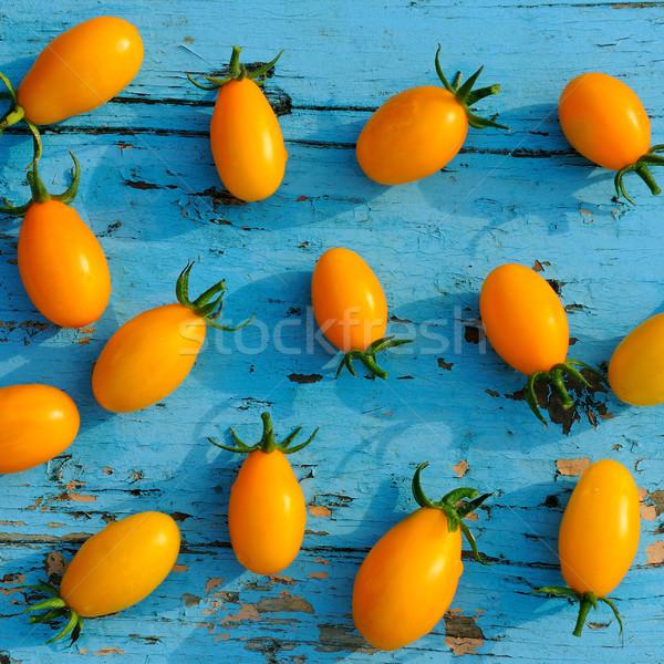Pomidory niebieski powierzchnia żółty mały Zdjęcia stock © alinamd