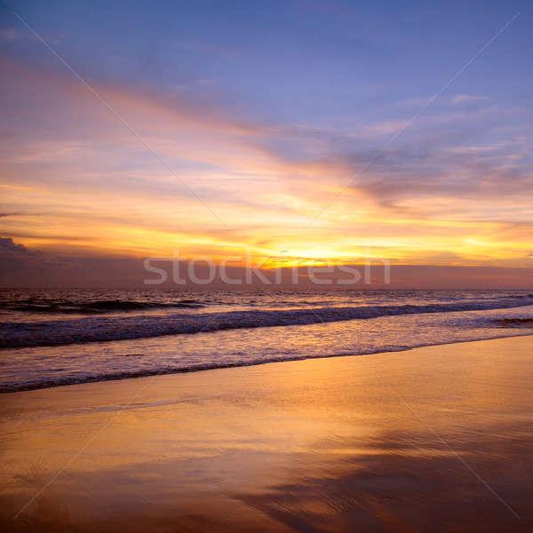 Fantástico pôr do sol oceano nuvens primavera sol Foto stock © alinamd
