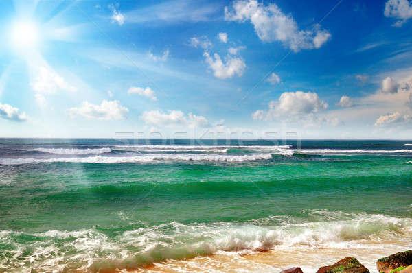 Oceaan zandstrand blauwe hemel water zon natuur Stockfoto © alinamd