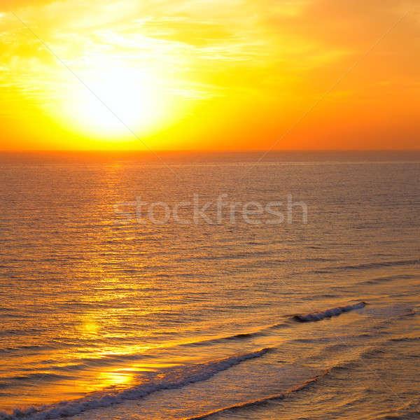 Bright sunrise over beach Stock photo © alinamd