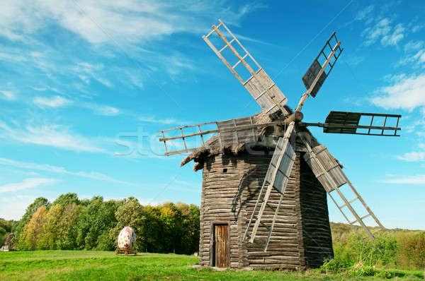 Old wooden windmill in the background of the autumn forest Stock photo © alinamd