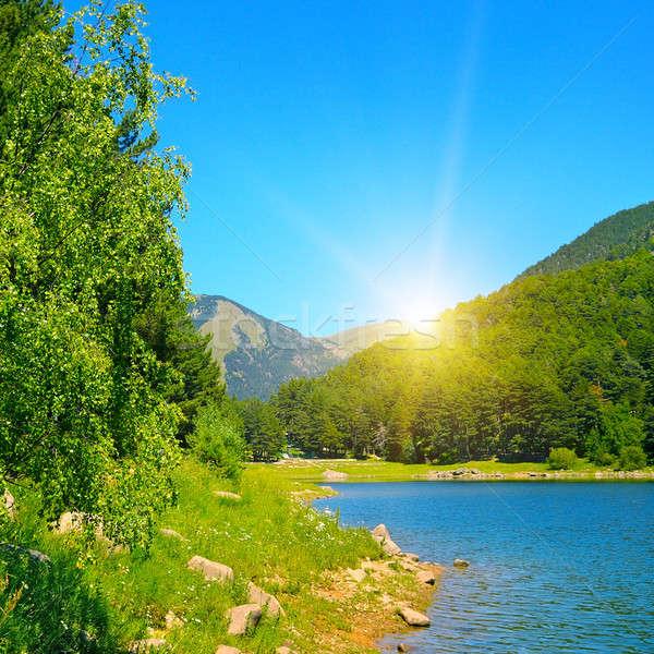 Pittoresque lac montagnes ciel bleu ciel arbre Photo stock © alinamd