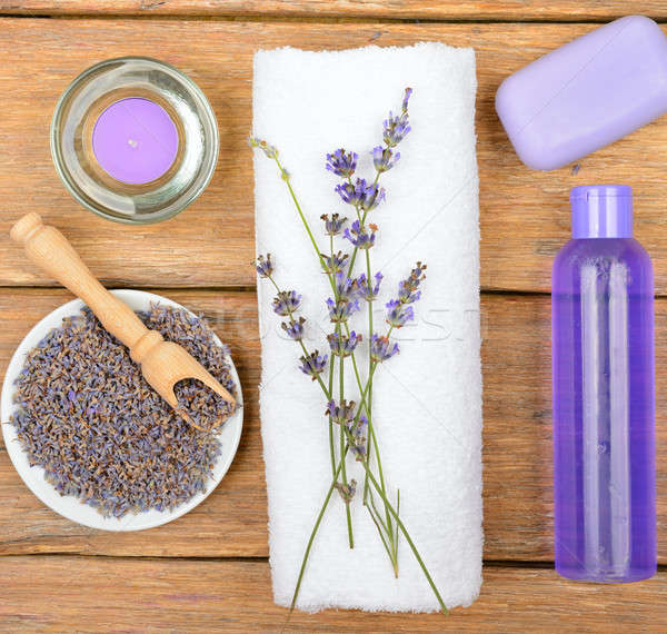 Cosmetics and an aromatic candle made from lavender flowers on a Stock photo © alinamd