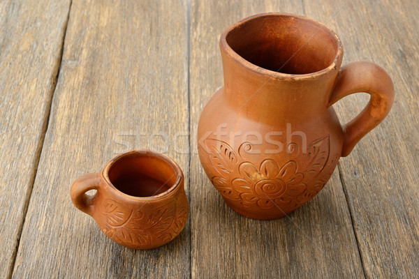 crock and a cup on a wooden surface Stock photo © alinamd