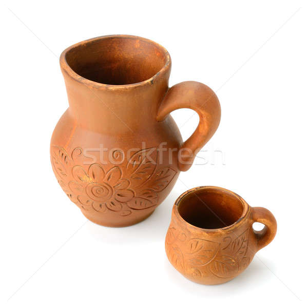 clay jug and a mug isolated on white background Stock photo © alinamd