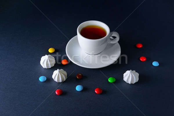 Cup tea and sweets on dark background Stock photo © alinamd