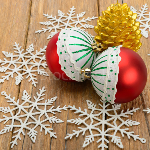 Christmas decorations and candle in on a wooden surface Stock photo © alinamd