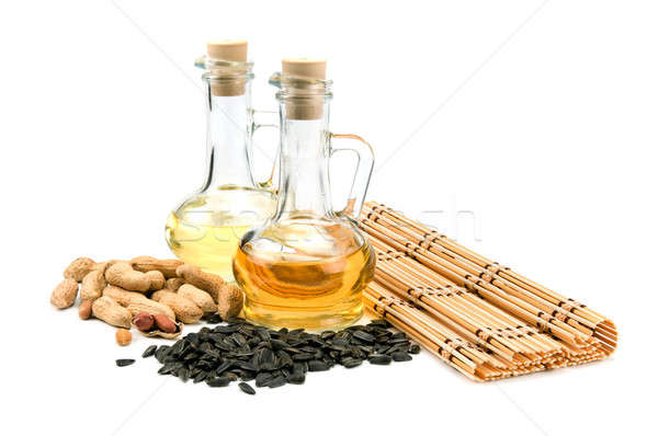 Sunflower seeds, peanuts and bottle of oil Stock photo © alinamd