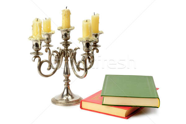 candlestick and books isolated on white background Stock photo © alinamd