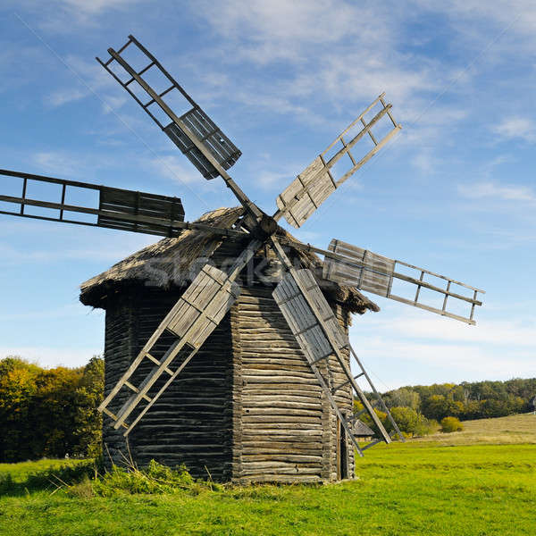 old wooden windmill in a field Stock photo © alinamd