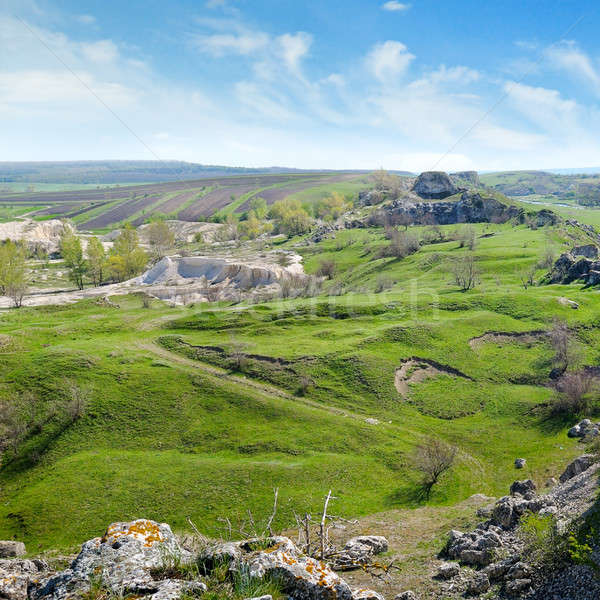 Deposits of limestone, quarry, green hills and rural landscape Stock photo © alinamd