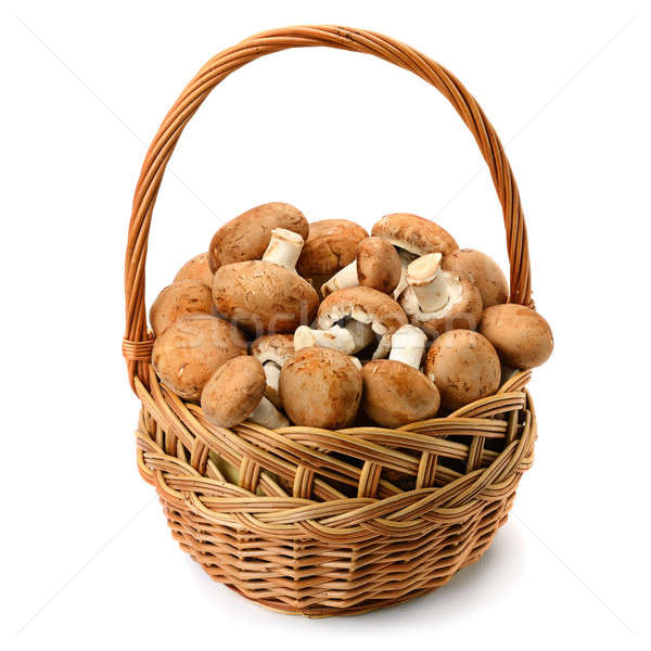 Champignons in wicker basket isolated on white background. Stock photo © alinamd