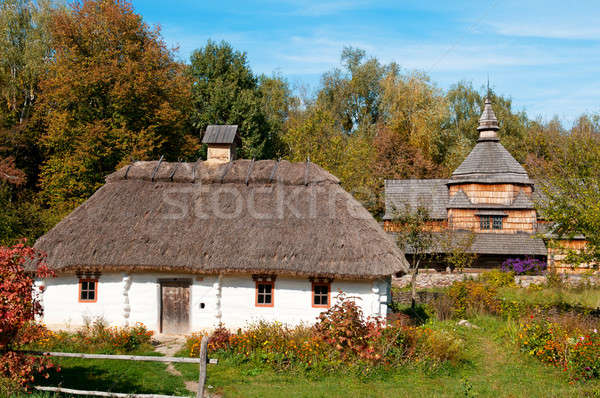 Old wooden house and a wooden Orthodox Church Stock photo © alinamd