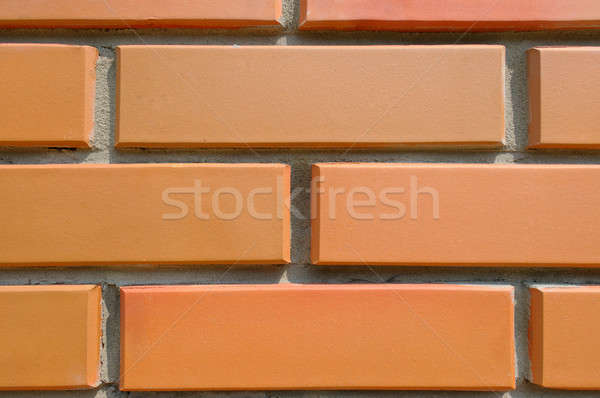 Stock photo: Detail of the house wall. Background of facing bricks