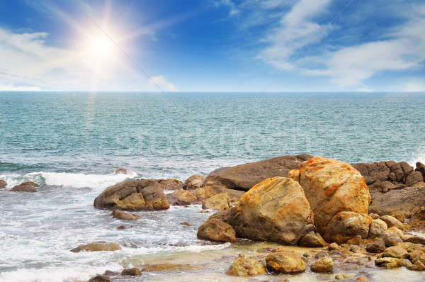 Stockfoto: Oceaan · pittoreske · strand · blauwe · hemel · water · zon