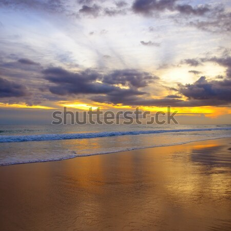 Zonsondergang oceaan strand water wolken voorjaar Stockfoto © alinamd
