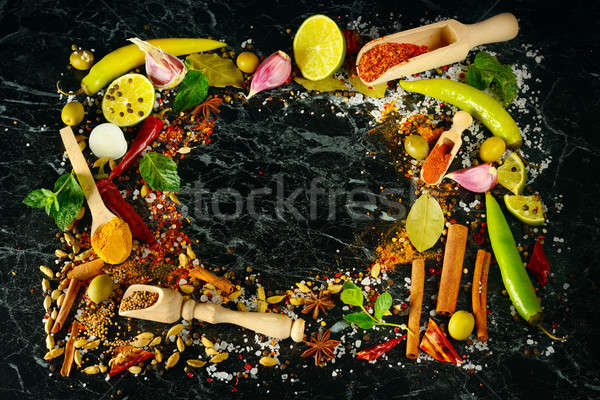 Variety of spices and herb on kitchen table. Stock photo © alinamd