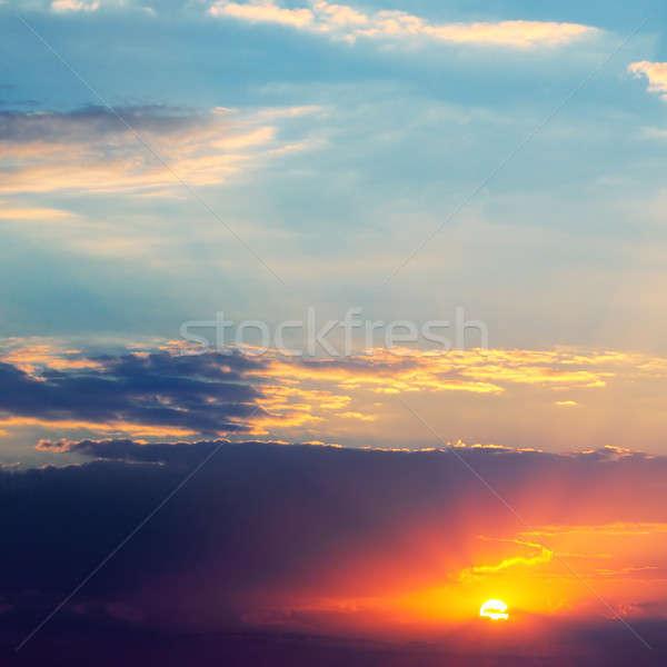 Fényes naplemente égbolt sötét felhők nap Stock fotó © alinamd