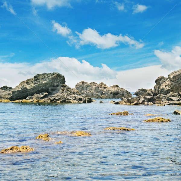 Stockfoto: Oceaan · pittoreske · strand · blauwe · hemel · water · zee