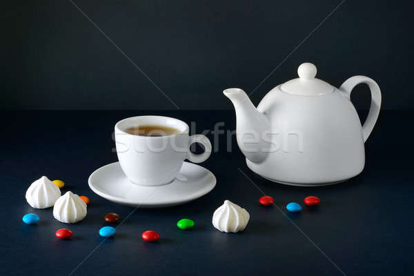 White cup and tea pot on a black background. Stock photo © alinamd