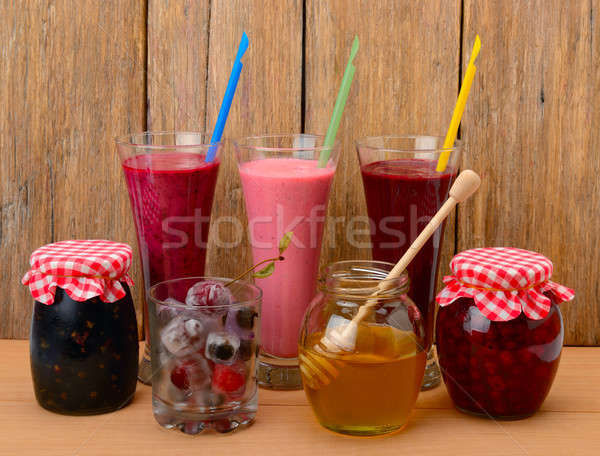 Set of berry smoothies, jams and frozen berries Stock photo © alinamd