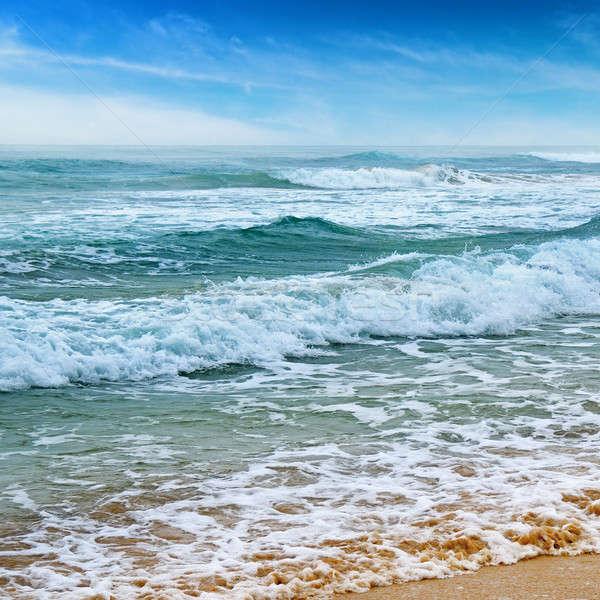 Zeegezicht zand strand blauwe hemel wolken achtergrond Stockfoto © alinamd