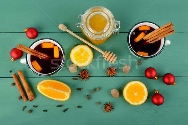 Hot red mulled wine on wooden background with christmas spices,  Stock photo © alinamd