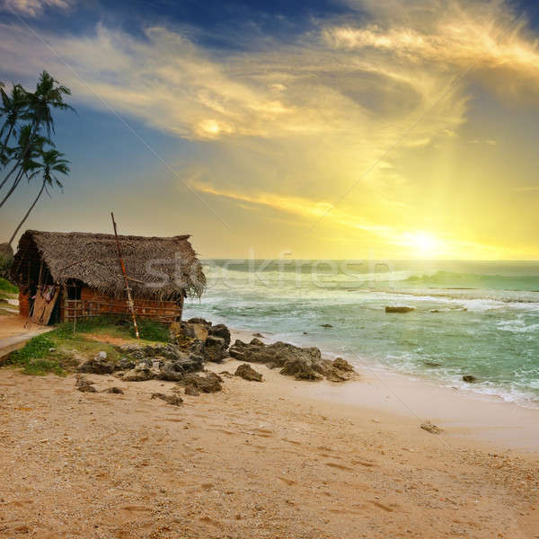 An old fisherman's hut on the shore of a picturesque ocean and a Stock photo © alinamd