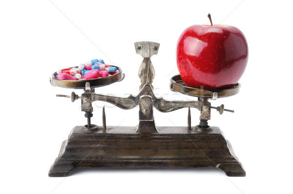 bowls of scales, apple and pills Stock photo © alinamd