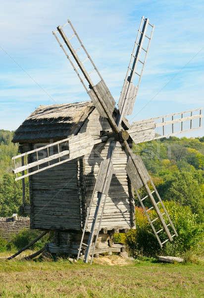 wooden windmill against the blue sky Stock photo © alinamd